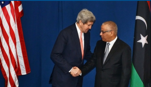 US Secretary of State John Kerry shakes hands with Libyan Prime Minister Ali Zidan during the Rome Ministerial Conference on Libya in Rome, Italy on March 6, 2014. (Photo: US State Department)